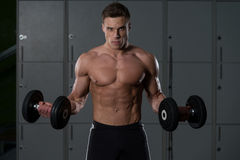Bodybuilder Exercise With Dumbbells Royalty Free Stock Photo