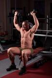 Bodybuilder exercising Stock Photo
