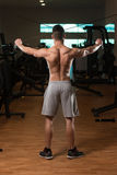 Bodybuilder Exercising Back On Cable Machine Stock Photography