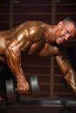 Bodybuilder Exercising Back With Dumbbells Royalty Free Stock Image