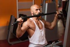 Bodybuilder Exercising Back In Gym Royalty Free Stock Photos