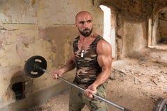 Free Bodybuilder Exercising Biceps In Shelter Stock Photos - 101438403