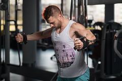 Bodybuilder Exercising Chest On Machine Stock Images