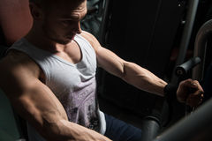 Bodybuilder Exercising Chest On Machine Royalty Free Stock Photos