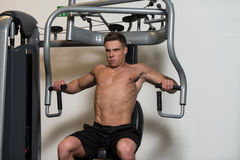 Bodybuilder Exercising Chest Stock Photos
