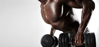 Bodybuilder exercising with dumbbells royalty free stock image