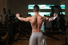 Bodybuilder Exercising Shoulders On Cable Machine Royalty Free Stock Photo