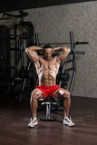 Bodybuilder Exercising Triceps With Barbell Stock Photo
