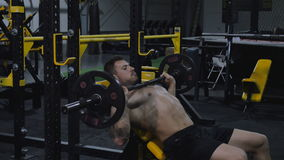 Bodybuilder exercising with weights stock footage