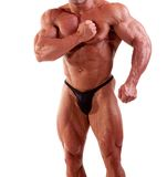 Bodybuilder flexing Stock Image