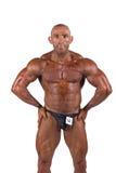 Bodybuilder flexing Royalty Free Stock Photo