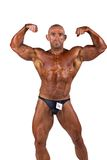 Bodybuilder flexing Stock Photography