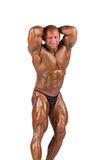 Bodybuilder flexing Royalty Free Stock Photo