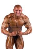 Bodybuilder flexing Stock Photography