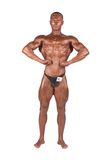 Bodybuilder flexing Royalty Free Stock Images