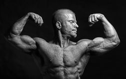 Bodybuilder flexing biceps Stock Photography