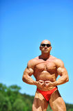 Bodybuilder flexing his muscles outdoors Royalty Free Stock Image