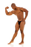Bodybuilder flexing muscles Royalty Free Stock Photos
