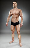 Bodybuilder full length Royalty Free Stock Image