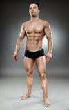 Bodybuilder full length Royalty Free Stock Image