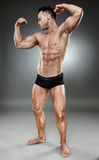 Bodybuilder full length Stock Photography