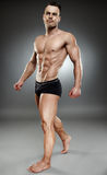 Bodybuilder full length Royalty Free Stock Photography