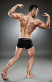 Bodybuilder full length Royalty Free Stock Photos