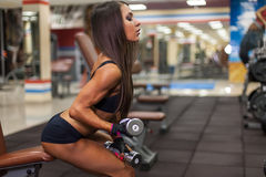 Bodybuilder girl with barbell Stock Photos