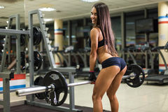 Bodybuilder girl with barbell Stock Image