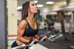 Bodybuilder girl with barbell Royalty Free Stock Images