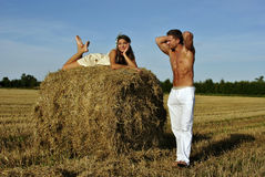 Bodybuilder with a girl in the countryside Stock Image