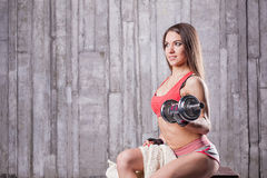 Bodybuilder girl with dumbbell Royalty Free Stock Photography
