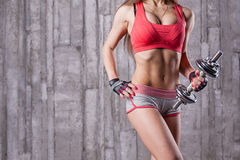 Bodybuilder girl with dumbbell Stock Photography