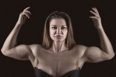 Bodybuilder girl with hands raised up. Stock Images
