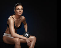 Bodybuilder girl resting after workout Stock Photo