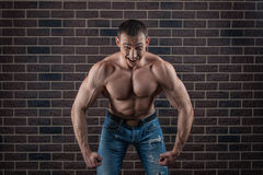 Bodybuilder growls menacingly. Bodybuilder threatening growls much straining your muscles Stock Photo