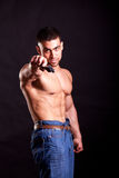 Bodybuilder with gun Royalty Free Stock Image