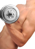 Bodybuilder guy with dumbbells Stock Photography