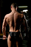 Bodybuilder in the gym. Training shot of young muscular man in the gym Stock Image