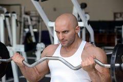 Bodybuilder in gym Stock Image