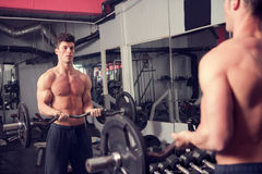 Bodybuilder in the gym exercising Stock Images