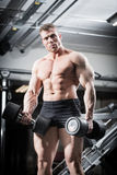 Bodybuilder in gym at fitness training with barbells Royalty Free Stock Photo