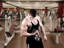 Bodybuilder at gym Stock Image