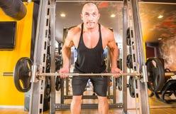 Bodybuilder at gym Stock Images
