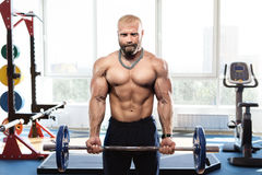 Bodybuilder in the gym training with bar Royalty Free Stock Photo