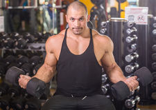Bodybuilder at gym Stock Image