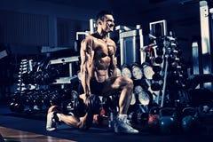 Bodybuilder in gym Stock Photo