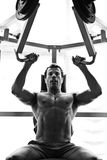 Bodybuilder hard training in the gym Stock Photo