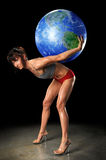 Bodybuilder Holding Earth On Her back Royalty Free Stock Photography