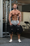 Bodybuilder Holding Weights In Hand Royalty Free Stock Photos